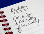 Close-up of a notepad with resolutions for a healthier lifestyle; going to gym, eat healthy, quit smoking.