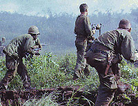 Three infantrymen on patrol in Vietnam