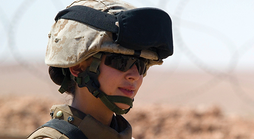 Female soldier in profile wearing helmet and protective gear.