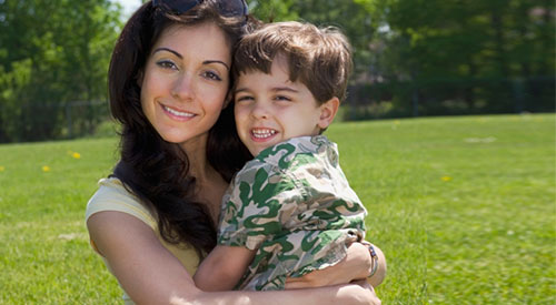 Mother and young son outdoors