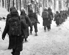 Soldiers during World War II walking in the snow