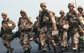 Gulf War soliders marching in uniform with gear.