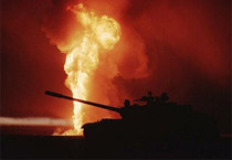 tank with fire in background during the Gulf War