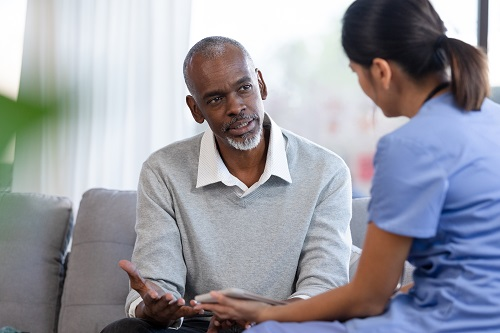 Doctor speaking with older man