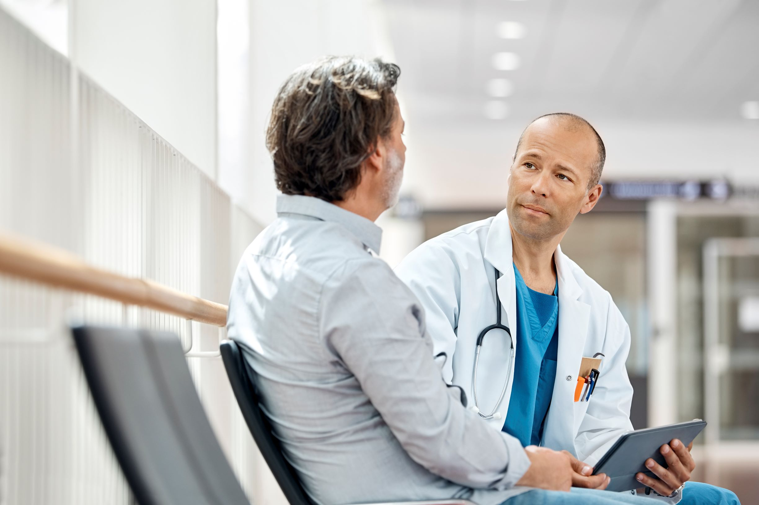 Doctor speaking with older male