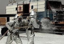 Fireman spraying Aqueous Film Forming Foam