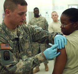 Female Servicemember getting vaccinated