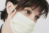 Woman wearing a  surgical mask