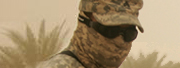 Closeup of soldier in goggles and camouflage with fabric  covering face in the  desert.
