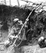 World War I soldier in trench wearing gasmask