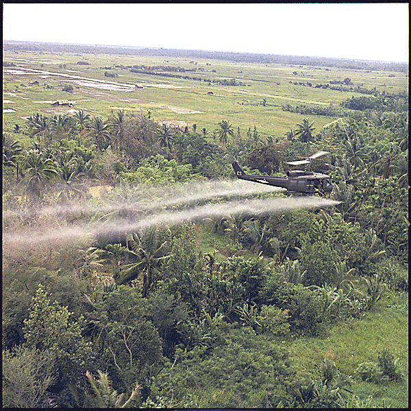 Helicopter spraying herbicide over jungle in Vietnam