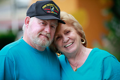 A Vietnam Veteran poses with his wife.