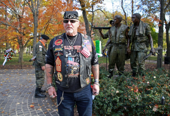 Vietnam Veteran standing in front of memorial on the National Mall for Veterans Day 2014