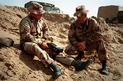 Marine corps journalist interviews a gunnery sergeant during Operation Desert Storm.