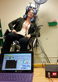 WRIISC staff testing out a NASA-designed rotational chair.