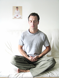 Man in seated yoga pose