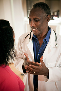 Doctor speaking to a female patient