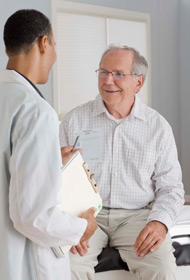 Doctor talking to older male patient