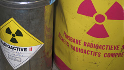 Two containers marked with radioactive materials warnings