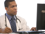 Medical professional reading text on computer screen