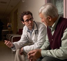 Doctor talking with male patient