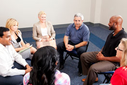A group of people sitting at a counseling session