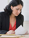 Woman reviewing documents at her desk