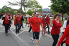 Several VA employees walking and wearing red in support of VA2K