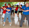 A group of VA employees dancing during a VA2K event