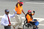 A man pushing a woman in wheelchair