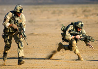 Two soldiers in combat gear running